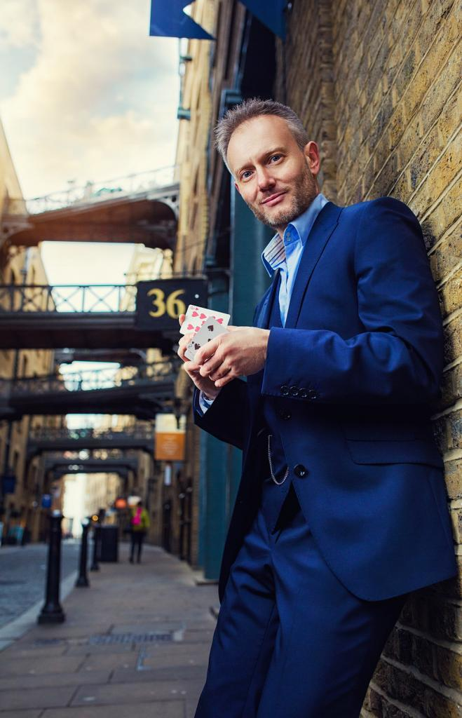 Corporate Magician,Simon Alexander shuffles cards in London street