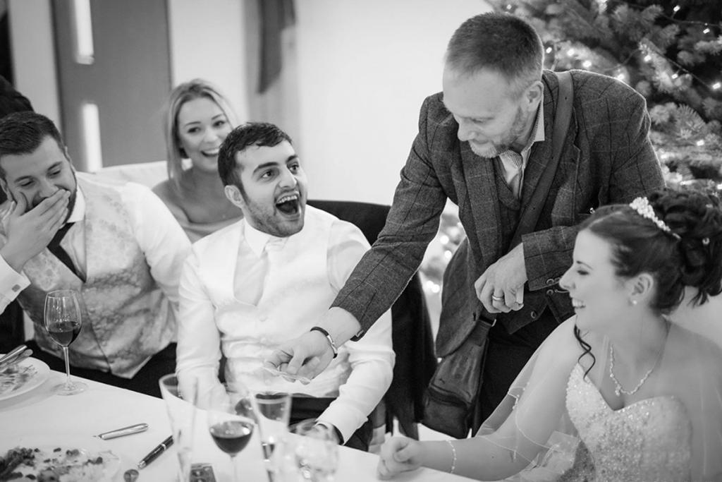 Wedding Magician performs to gasping bride and groom
